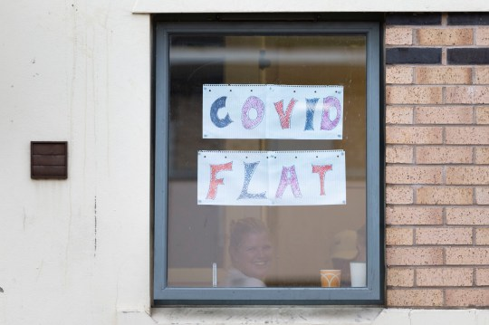 CARDIFF, WALES - OCTOBER 13: Students self isolating at Talybont South halls of residence at Cardiff University display messages in their window on October 13, 2020 in Cardiff, Wales. Students at the Cardiff University Talybont South halls were tested over the weekend for coronavirus as part of precautionary measures to prevent the spread of the virus. There are currently 1,398 students who have reported to the university that they are self isolating. (Photo by Matthew Horwood/Getty Images)