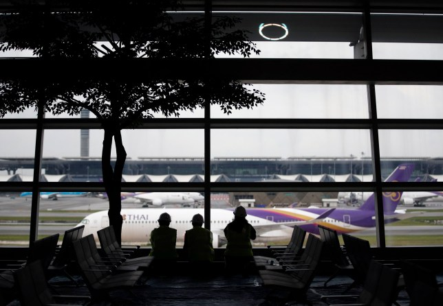 Thai airways flight and people at airport
