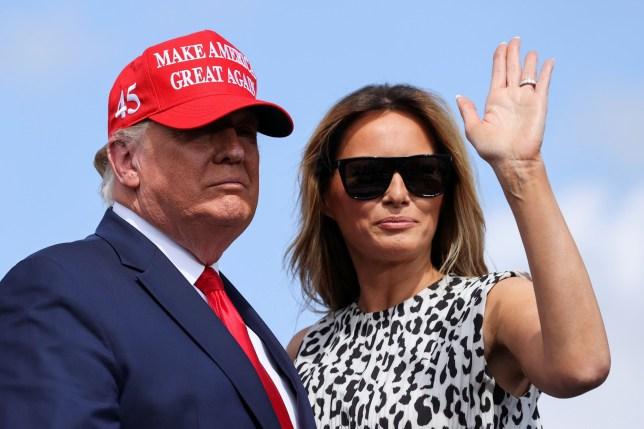 First lady Melania Trump waves next to U.S. President Donald Trump