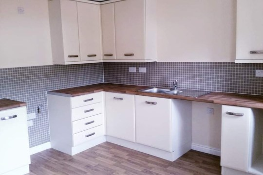 Symone Davies' kitchen before its makeover