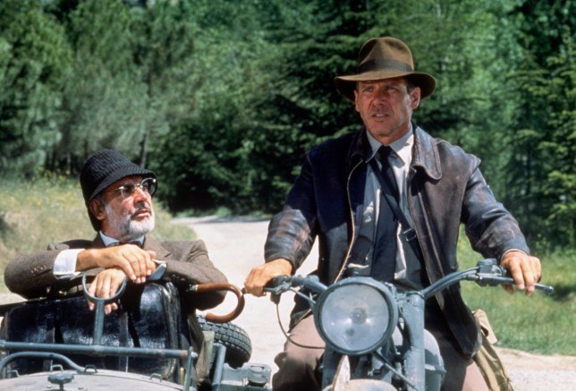 American actor Harrison Ford as the eponymous archaeologist and Scottish actor Sean Connery as his father Henry Jones during the motorcycle chase scene from the film 'Indiana Jones and the Last Crusade', 1989