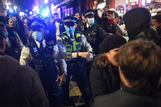 LONDON, ENGLAND - NOVEMBER 04: Police officers move crowds in Soho on November 4, 2020 in London, England. Non-essential businesses, including pubs and restaurants, will be forced to close from Thursday, Nov 5, following a new national lockdown in England. (Photo by Peter Summers/Getty Images)