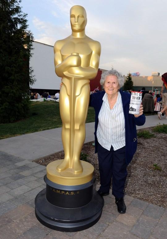 Elsa Raven posing with Oscar award
