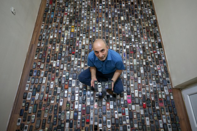 Phone repairman Sehabettin Ozcelik, collecting mobile phones over 20 years, now owns a thousand of them, displays his collection in his house