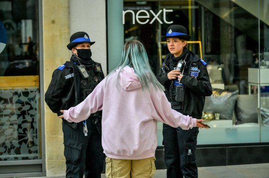 Police community support officers talk to a passer-by in Bath as the England begins a second national lockdown. PA Photo. Picture date: Thursday November 5, 2020. See PA story HEALTH Coronavirus. Photo credit should read: Ben Birchall/PA Wire