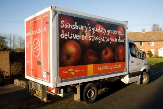 Sainsbury's supermarket delivery van in village street, Shottisham, Suffolk, England