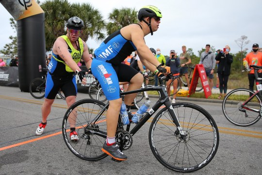 PANAMA CITY BEACH, FLORIDA - NOVEMBER 07: Chris Nikic begins the bike portion of the IRONMAN Florida on November 07, 2020 in Panama City Beach, Florida. Chris Nikic is attempting to become the first Ironman finisher with Down syndrome. (Photo by Jonathan Bachman/Getty Images for IRONMAN)