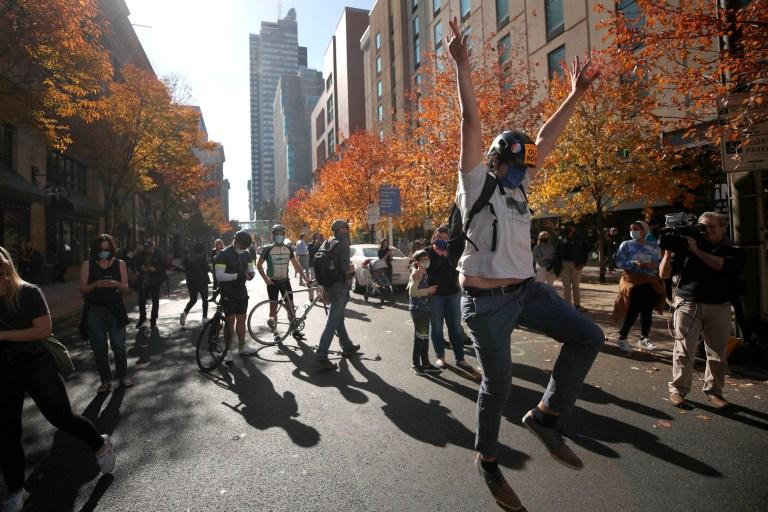 A man celebrates Saturday, Nov. 7, 2020, in Philadelphia, after Democrat Joe Biden defeated President Donald Trump to become 46th president of the United States. (AP Photo/Rebecca Blackwell)
