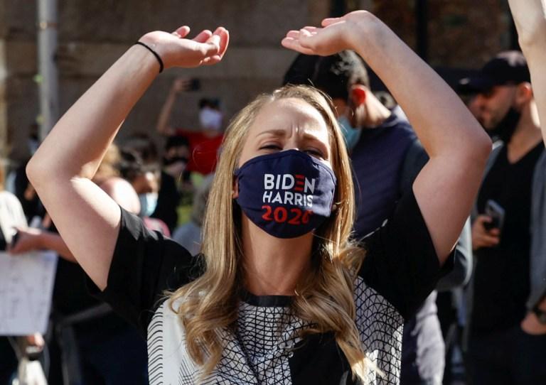 A woman reacts as media announce that Democratic U.S. presidential nominee Joe Biden has won the 2020 U.S. presidential election, in, Philadelphia, Pennsylvania, U.S., November 7, 2020. REUTERS/Rachel Wisniewski