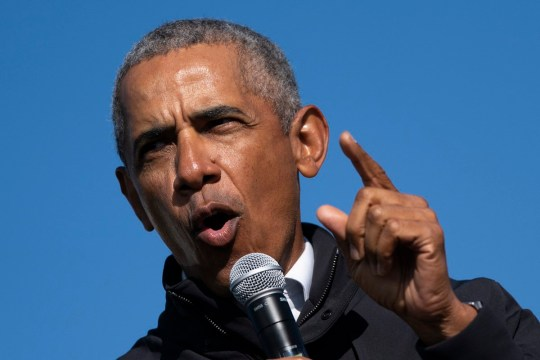 FLINT, MI - OCTOBER 31: Former U.S. President Barack Obama speaks during a drive-in campaign rally for Democratic presidential nominee Joe Biden at Northwestern High School on October 31, 2020 in Flint, Michigan. Biden is campaigning with former President Obama on Saturday in Michigan, a battleground state that President Donald Trump narrowly won in 2016. (Photo by Drew Angerer/Getty Images)