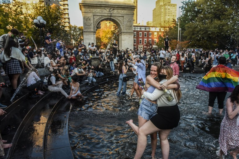 NEW YORK, NY - NOVEMBER 07: People stand in the fountain as they celebrate in Washington Square Park after it was announced that Democratic nominee Joe Biden would be the next U.S. President on November 7, 2020 in New York City. According to several news outlets presidential nominee Joe Biden has defeated incumbent U.S. President Donald Trump to become the 46th President of the United States. (Photo by Stephanie Keith/Getty Images)