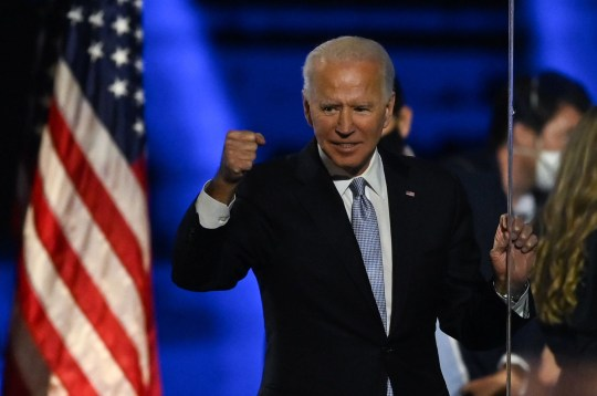 TOPSHOT - US President-elect Joe Biden holds up his fist after delivering remarks in Wilmington, Delaware, on November 7, 2020, after being declared the winners of the presidential election. (Photo by Jim WATSON / AFP) (Photo by JIM WATSON/AFP via Getty Images)