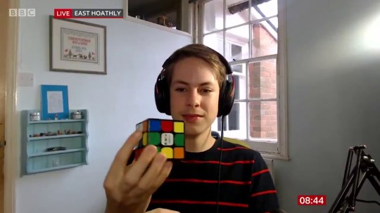 Rubik's Cube World Cup winner, Chris Mills solves the puzzle