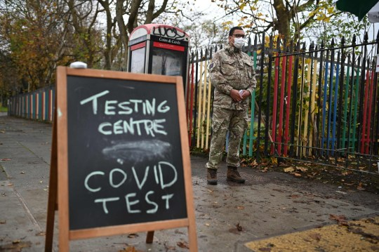 A chalk board sign is seen on the street outside a testing centre staffed by British Army soldiers of the 1st battalion Coldstream Guards at the Merseyside Caribbean Council Community Centre in Liverpool, north west England, on November 10, 2020 during a city-wide mass testing pilot operation. - Liverpool on November 6 began England's first city-wide trial of coronavirus testing in an attempt to prevent hospitals becoming overwhelmed during the country's second wave of the pandemic. All of the northwestern city's 500,000 residents as well as people working there will be offered repeat tests, even if asymptomatic, under the pilot trial, which will initially run for two weeks. (Photo by Oli SCARFF / AFP) (Photo by OLI SCARFF/AFP via Getty Images)
