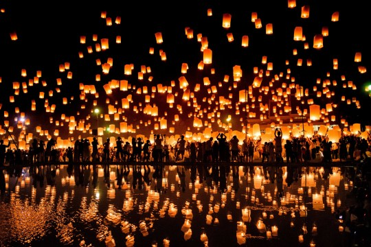 A crowd releases lanterns into the air as they celebrate the Yee Peng festival, also known as the festival of lights, in Chiang Mai on November 3, 2017.