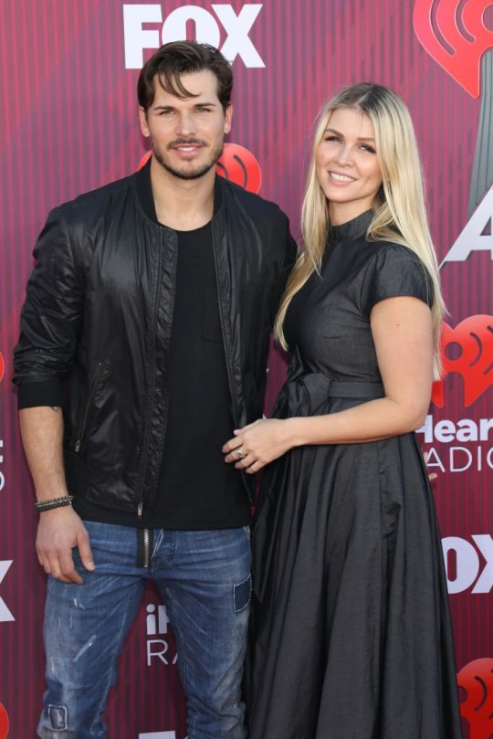 LOS ANGELES, CALIFORNIA - MARCH 14: Gleb Savchenko and Elena Iodanova arrive at the 2019 iHeartRadio Music Awards which broadcasted live on FOX at Microsoft Theater on March 14, 2019 in Los Angeles, California. (Photo by Toni Anne Barson/WireImage)
