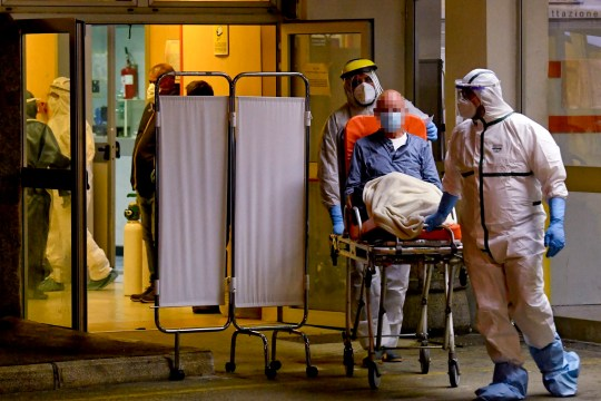 edical staff assist people with suspected cases of COVID-19 disease, arriving at the emergency room of the Cardarelli Hospital in Naples, Italy, 13 November 2020.