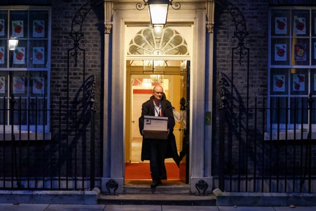 Dominic Cummings leaves Downing Street carrying a cardboard box.