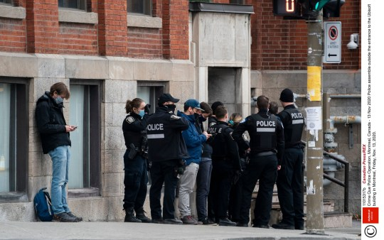 Mandatory Credit: Photo by Canadian Press/REX (11015317b) Police assemble outside the entrance to the Ubisoft building in Montreal, Friday, Nov. 13, 2020. Crime Que Police Operation, Montreal, Canada - 13 Nov 2020