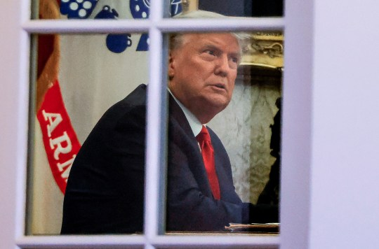 U.S. President Donald Trump sits at his desk in the Oval Office