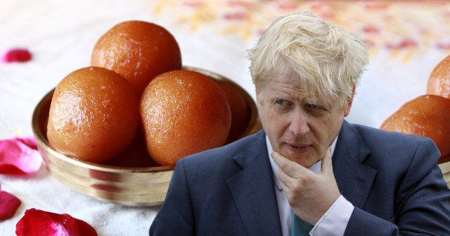 Boris Johnson strokes his chin as he stands in front of floating gulab jaman sweets floating in the background