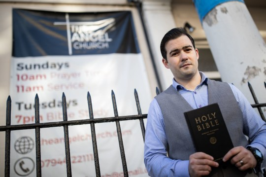 Pastor Regan King outside the Angel Church in Clerkenwell, London, after police officers stopped the evangelical church from holding a baptism service, which is in breach of the national coronavirus lockdown restrictions.