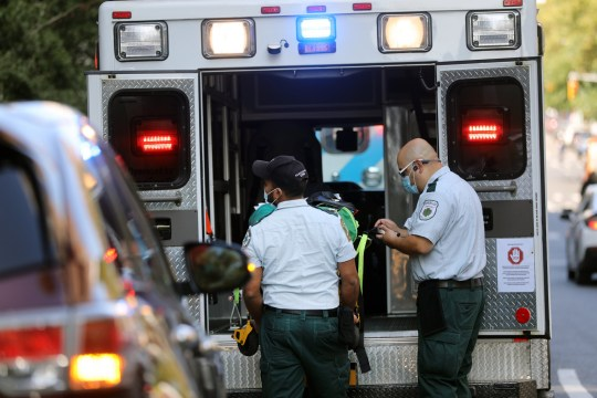NEW YORK, NEW YORK - SEPTEMBER 22: Medical workers load an ambulance outside of Mount Sinai Hospital in Manhattan, which has treated hundreds of COVID-19 patients since March, on September 22, 2020 in New York City. While New York???s infection rate is currently below one percent, the U.S. has reported more than 6.7 million confirmed cases and 200,000 deaths attributed to COVID-19, making it the world leader in both. (Photo by Spencer Platt/Getty Images)