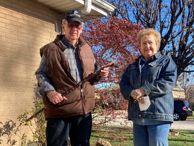 Dan Donovan, his wife Barbara, and Dan's antique shillelagh