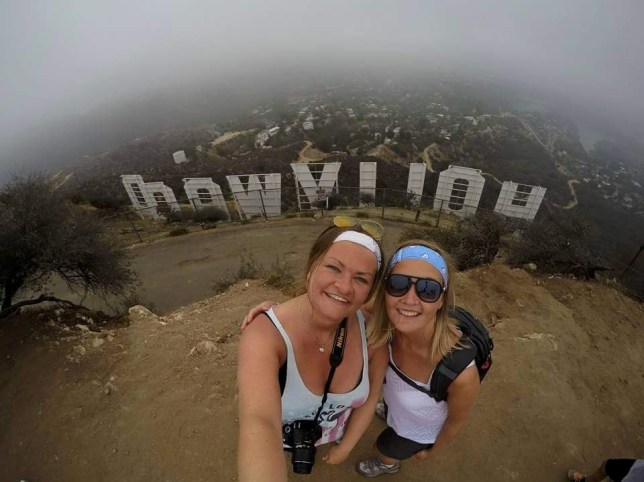 Katie Marshall (left), 36, and Nicola Rowbotham (right) , 33, at the Hollywood sign. See SWNS story SWLEtravellers; A 34-year-old woman who thought she was going to die when she was diagnosed with cancer made the brave decision to reject chemo and travel the world with her girlfriend. Katie Marshall, 36, and partner Nicola Rowbotham, 33, have been living in a campervan in the Canadian wilderness without internet, WiFi or electricity for eight months. The besotted couple managed to sneak into the country just before lockdown in March after quitting their jobs and selling all of their belongings. Katie was diagnosed with skin cancer in January 2018 but was given a devastating double-blow when doctors found she also had breast cancer just three months later. She had been on a 4,000 mile road trip with Nicola in the U.S. at the time and had to return to Manchester for urgent surgery to remove the tumour in May 2018. Katie refused chemotherapy following the surgery, which she said was ?more terrifying? than the cancer diagnosis, and opted for a natural course of treatment. The couple then spent time deciding to change their lifestyles to incorporate Katie's new holistic form of cancer treatment, save money, quit their jobs and travel the world - landing in Canada in March 2020. Katie, from Hattersley, Cheshire, said: ?When I got my diagnosis, the thought of chemotherapy was more terrifying than the diagnosis itself.