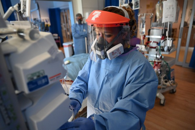 Members of the clinical staff wear personal protective equipment (PPE) as they care for patients at the Intensive Care unit at Royal Papworth Hospital in Cambridge, on May 5, 2020