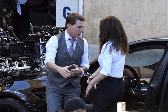 Tom Cruise and Hayley Atwell filming an action scene on Mission Impossible 7 set in Rome
