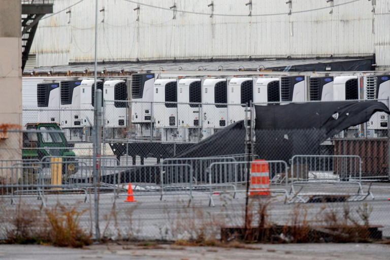Refrigerated trailers used to store bodies of deceased people are seen at a temporary morgue, during the COVID-19 pandemic in the Brooklyn borough of New York City, U.S., November 23, 2020. REUTERS/Brendan McDermid