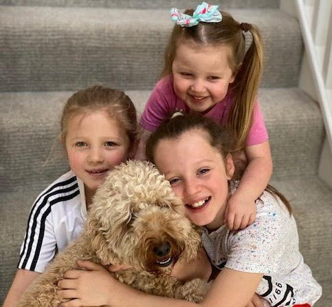 Benji the dog with (L-R) Scarlett Malley, Seren Malley (back) and Sienna Malley. See SWNS story SWSYcockapoo. A dog owner was left distraught after a farmer shot and killed her tiny cockapoo when it strayed onto his field.Kerri Malley, 40, was walking Benji, three, near a sheep field when he bolted away from her. She says the pooch ran off when it got a shock after it touched an electric fence. But by the time she found the pooch, he had been shot by the farmer who allegedly claimed the dog was worrying his animals.