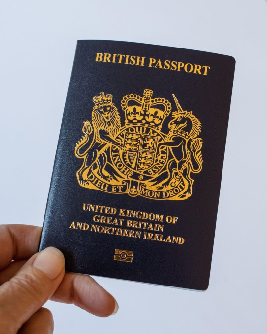 New blue British passport. (United Kingdom of Great Britain and Ireland) for post-Brexit on a plain background.