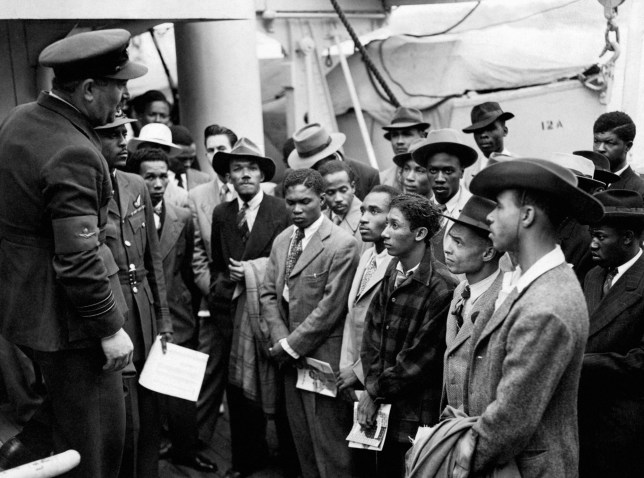 Jamaican immigrants welcomed by RAF officials from the Colonial Office after the ex-troopship HMT 'Empire Windrush' landed them at Tilbury.