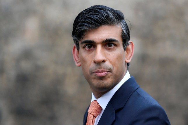 Rishi Sunak in a suit looking directly at the camera