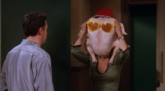 Courteney Cox's character Monica Geller with a turkey on her head in Friends.