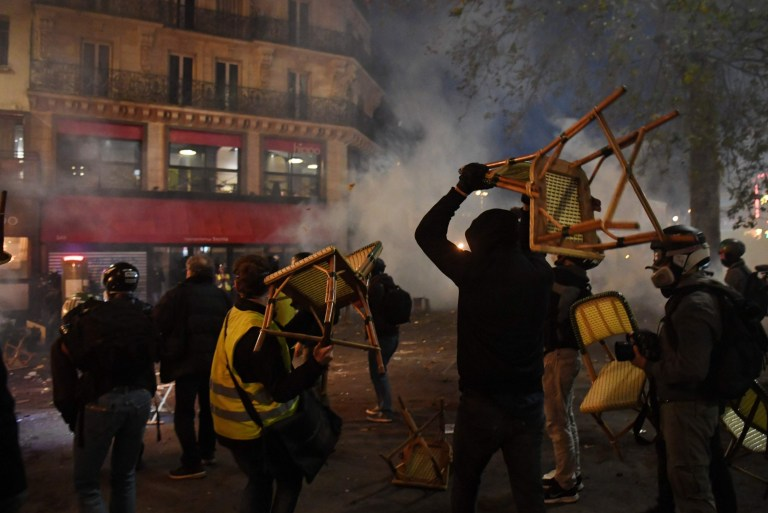 Demonstrators clashes with French riot police during a protest against the 'global security' draft law,
