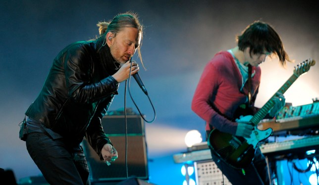 Thom Yorke, left, and Jonny Greenwood of Radiohead perform during the band's headlining set at the 2012 Coachella Valley Music and Arts Festival in Indio, Calif.