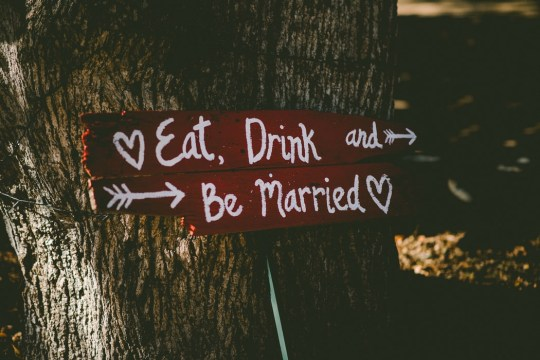 a sign that reads 'eat, drink and be married'