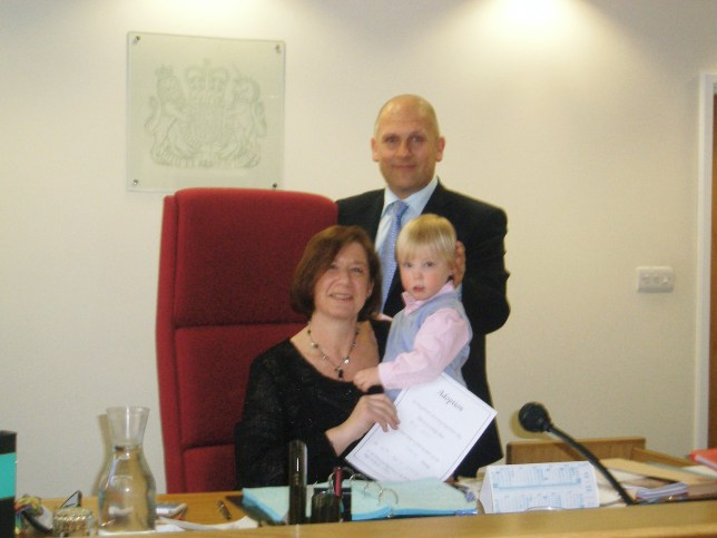 Karen Sloam and her husband adopting their child, Max