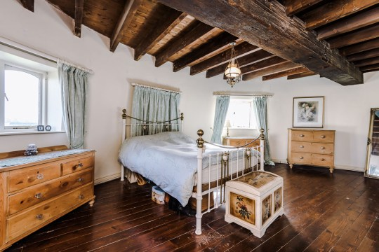 bedroom in converted mill up for sale