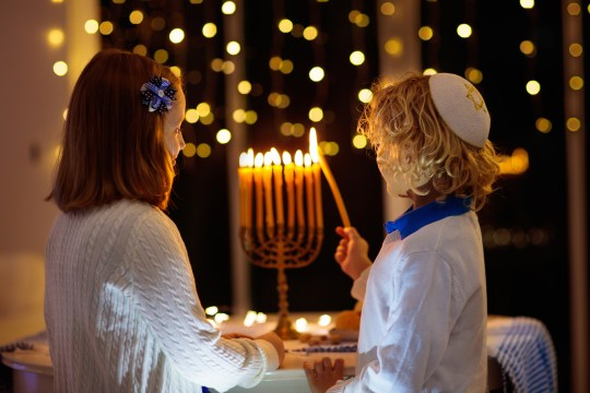 Children lighting a menorah