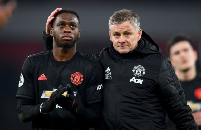 Ole Gunnar Solskjaer, Manager of Manchester United speaks to Aaron Wan-Bissaka of Manchester United after the Premier League match between Arsenal FC and Manchester United at Emirates Stadium on January 01, 2020 in London, United Kingdom.