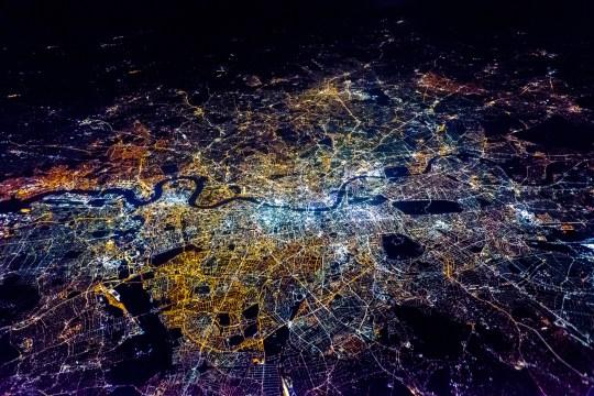 Full Frame Shot Of Illuminated City Against Sky At Night