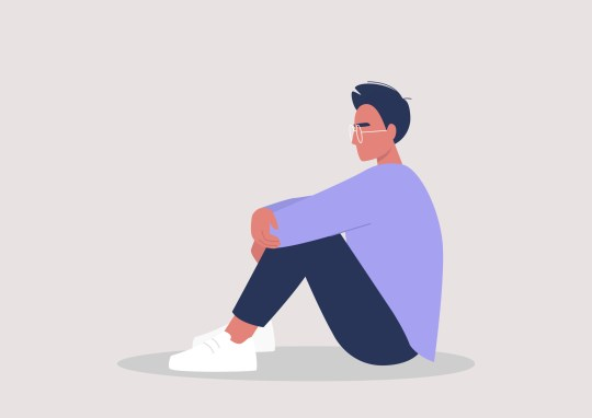 Young male character embracing their knees, emotional stress, mental health