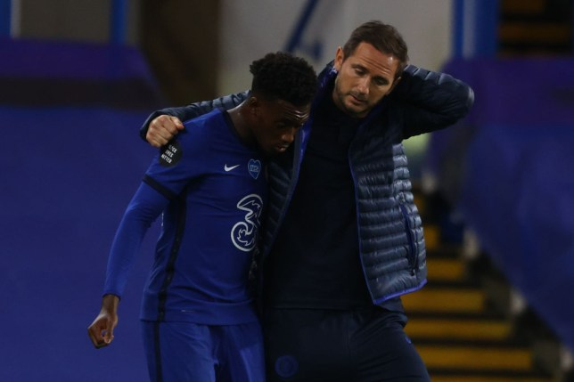 Chelsea's English head coach Frank Lampard (R) gestures with Chelsea's English midfielder Callum Hudson-Odoi at the final whistle during the English Premier League football match between Chelsea and Norwich City at Stamford Bridge in London on July 14, 2020.