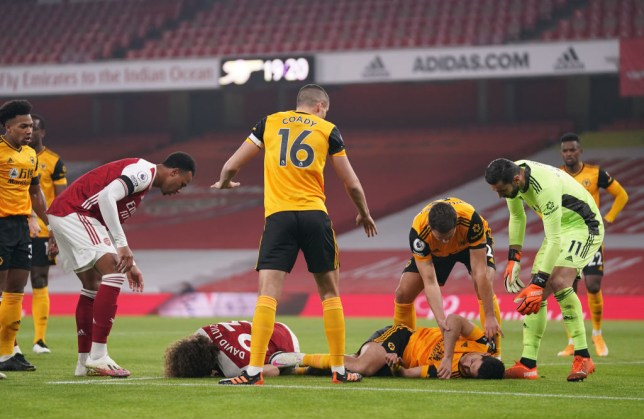 David Luiz and Raul Jimenez down in a heap after their clash of heads in Arsenal's Premier League defeat to Wolves