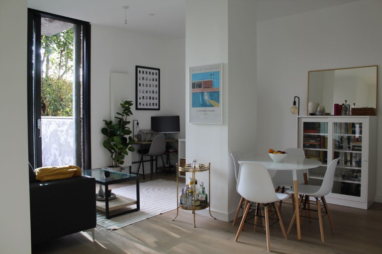 What I Rent: Kelsey, one-bedroom flat in Archway, London - view of living room, dining area, and desk