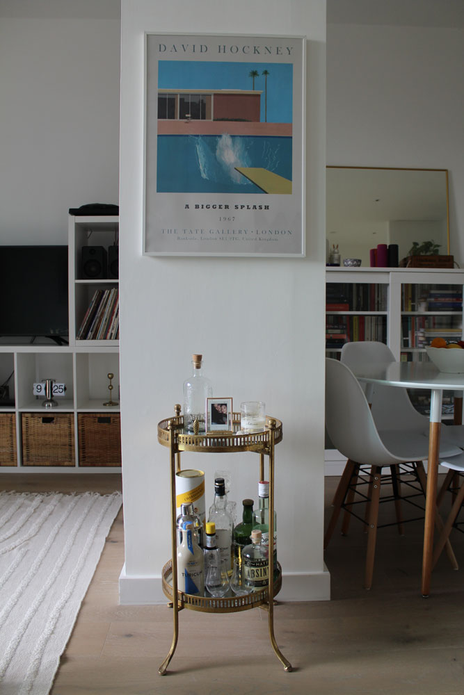 What I Rent: Kelsey, one-bedroom flat in Archway, London - drinks table with david hockney a bigger splash print